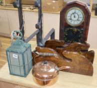 A pair of cast iron andirons, a whip rack, an American clock and metalware