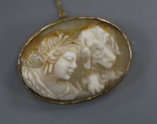 A 9ct mounted oval cameo brooch carved with the head a lady and a hound (a.f.), 34mm.