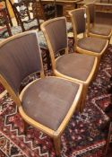 A set of four Heals oak dining chairs