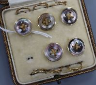 A cased set of early 20th century five (ex 6) 18ct and shell set dress studs.
