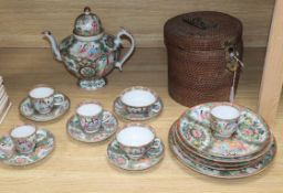 A group of 19th century Chinese famille rose tea wares including a teapot in a basket