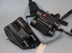 A pair of Leica 8 x 42 BA Trinovid binoculars, number 1016941 and a pair of Zeiss 10 x 40 B T*P*