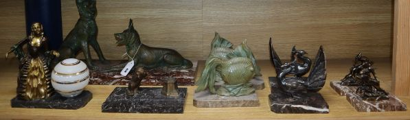 Art Deco patinated spelter figures comprising three pairs of bookends, one inkwell and lamp and a