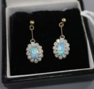 A pair of 9ct, black opal and diamond set oval cluster drop earrings, drop 18mm.