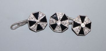 A pair of white metal, black onyx and diamond set octagonal cufflinks, one hallmarked platinum,