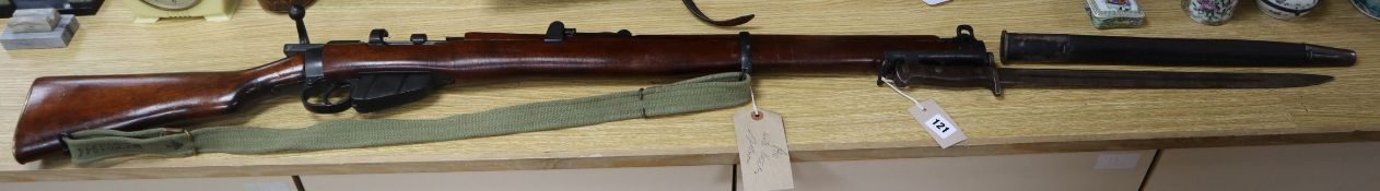 A .303 Royal Enfield replica rifle and a real bayonet length 157cm incl. bayonet