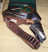 A cased model revolver, a model revolver on holster and a 12 bore cartridge belt