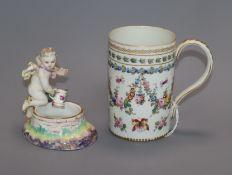 A Berlin figural salt and a Dresden mug height 11.5cm