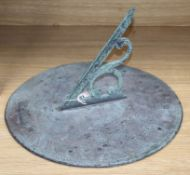 A bronze sundial with gnomon, of star design, inscribed 'Brixton 1795', dia 46cm, H 45cm (max)