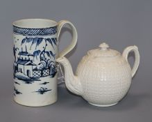 A late 18th century pearlware blue and white 'Chinese landscape' mug, and a Wedgwood type white