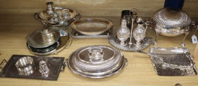 A collection of silver plate including revolving breakfast dish, entree dishes, cream and sugar on