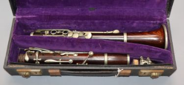 A rosewood clarinet by M. Barr, Victoria St, London, nickel-mounted, cased (mouthpiece a.f.)