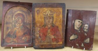 Three Russian painted wood icons largest 27cm