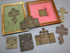 Eight 19th century Russian brass or copper crucifixes or icons