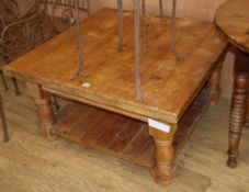 A pine square two tier coffee table W.91cm