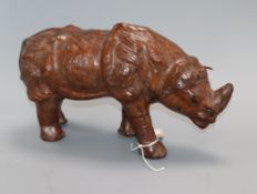 A leather model of a rhino bearing a stamped mark length 30cm approx.