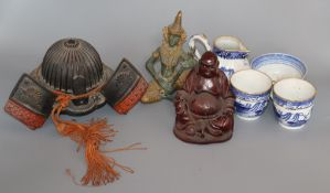 A bronze model of a Kabuto, a Thai bronze, a carved wood Buddha and 4 pieces of blue and white