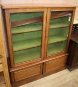 A late Victorian mahogany bookcase, in two parts W.122cm