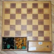 A Staunton pattern stained and natural chess set and board