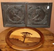 Two figurative carved panels and a circular parquetry panel Diam. 60cm