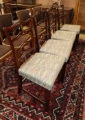 A harlequin set of four George III mahogany ladderback dining chairs, with upholstered seats and