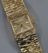 A lady's 1960's textured 9ct gold Accurist manual wind wrist watch, with spare link.
