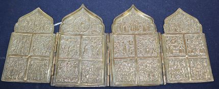 A 19th century Russian cast brass tetraptych icon