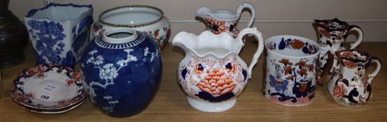 A collection of Victorian and later pottery two handled cider mugs, tankards, jugs and dishes