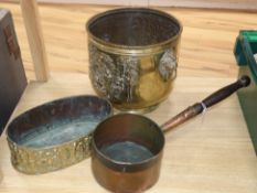 A 19th century oval embossed brass planter and an early copper pan and a Dutch brass log bin