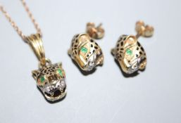 A modern 14ct, ruby and diamond set leopard's head pendant on a 9ct chain and a pair of 14ct,
