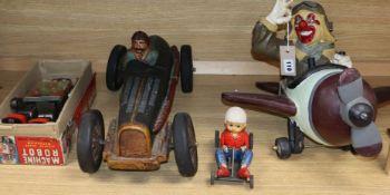 "A ""Machine robot"" toy, boxed, a tin plate racer, a clown pilot and a similar car"