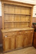 A 19th century pine dresser and rack W.144cm