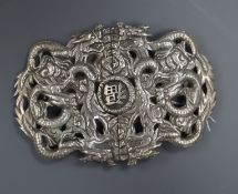 A Chinese Export white metal 'dragon' belt buckle, by Luen Wo, 10.2cm.