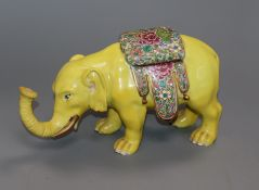 A Samson of Paris yellow model of a caparisoned elephant in Chinese style width 24cm