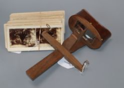 A wooden stereoscopic viewer and a small collection of cards including Kent, Sussex and