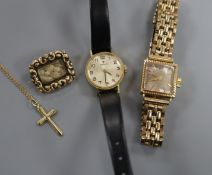 A Cortebert 18k 750 cased ladys' wristwatch, a 375 cross pendant on fine chain, a pinchbeck mourning
