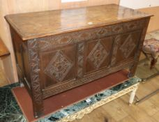 An early 18th century carved oak coffer W.117cm