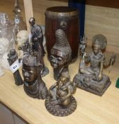 Two Benin style bronze heads, an African hardwood drum, two modern Maasai resin figures and two