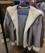A silver mink with cream mink edging and a hood
