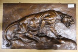 A bronzed plaster plaque of a tiger, signed TH. Cartier 37 x 59cm
