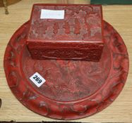 A Chinese cinnabar lacquer box with bone contents and a similar 'dragon' dish