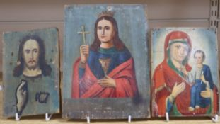 Three Russian painted wood icons, 19th/20th century largest height 23cm