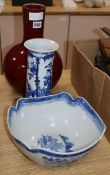 A Chinese blue and white sleeve vase, similar bowl and a sang de boeuf vase