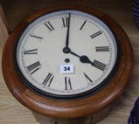 An oak cased wall clock