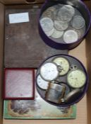 A collection of mixed coinage, WWI medals, pocket watches and cap badges, etc.