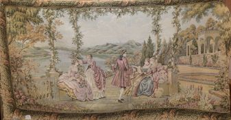 A Hines of Oxford machine made tapestry hanging depicting figures in a romantic lakeside setting 180