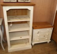 A Victorian style white painted three drawer bedside chest, with pine top and a four shelf open