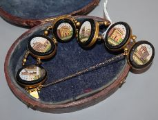 An early 20th century gilt metal and oval micro mosaic panel set bracelet.