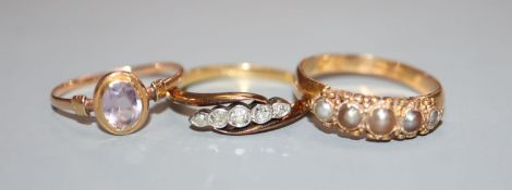 A diamond five-stone ring, 18ct setting and two other rings, 18ct and yellow metal.