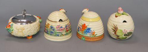 Four Clarice Cliff preserve jars